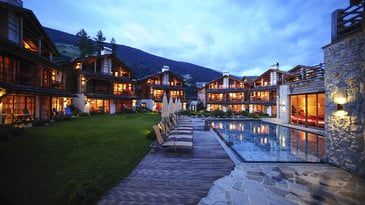 Post alpina family mountain chalets villaggio di montagna post alpina family hotel - Hotel con piscina montagna ...